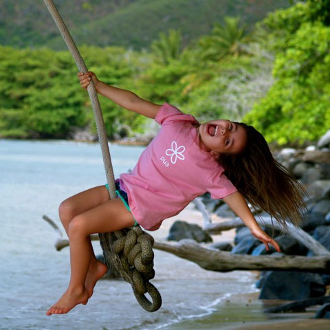 Girl on rope swing